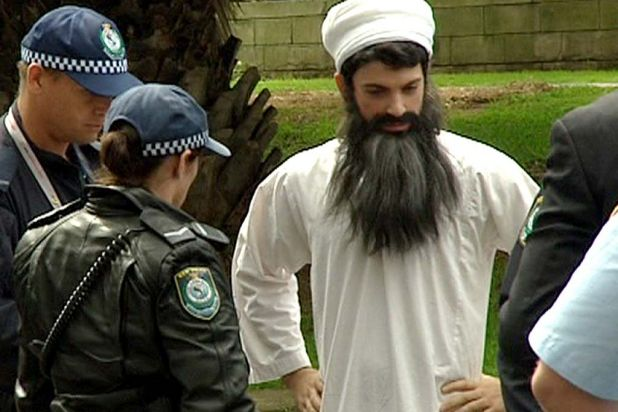 The Chaser team's costumed Chas Licciardello being arrested at the 2007 APEC conference.