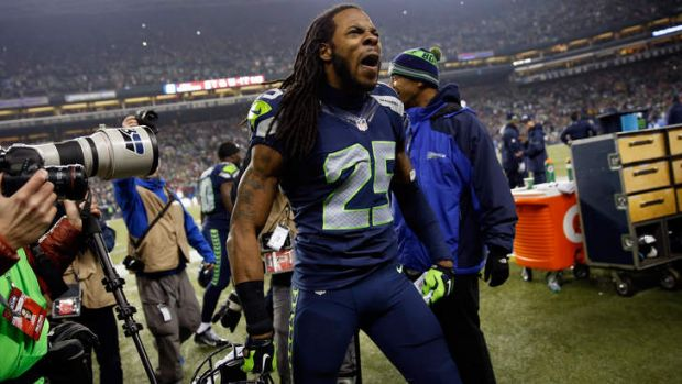 Sherman celebrates the winning play.