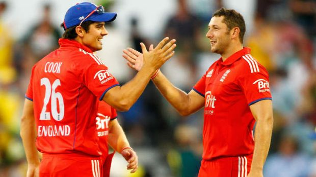 Finally: Alastair Cook and Tim Bresnan of England celebrate Friday night's win.