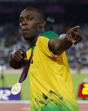 Usain Bolt poses with the 200m gold medal at the  London Olympics.