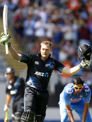 Martin Guptill acknowledges the applause after reaching his century.