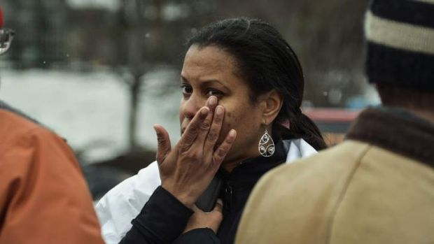 Tarah William of Lanham, Maryland reacts after she was evacuated from a building following a shooting at a shopping mall ...