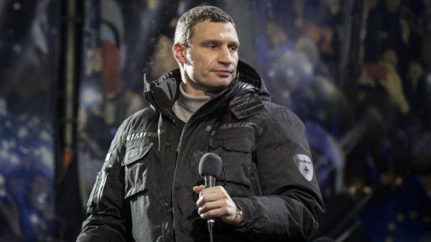 """Talks will continue"": Opposition leader Vitali Klitschko speaks to anti-government protesters  in Independence Square, Kiev."