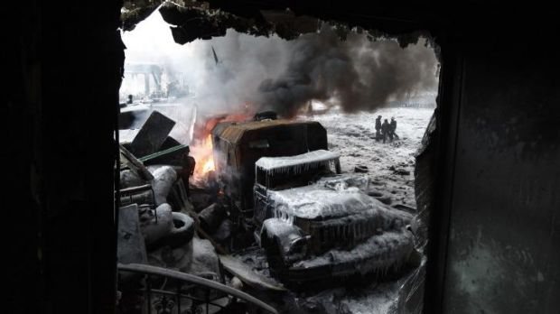 Aftermath: A burnt truck is seen at the site of clashes between anti-government protester and riot police in Kiev.