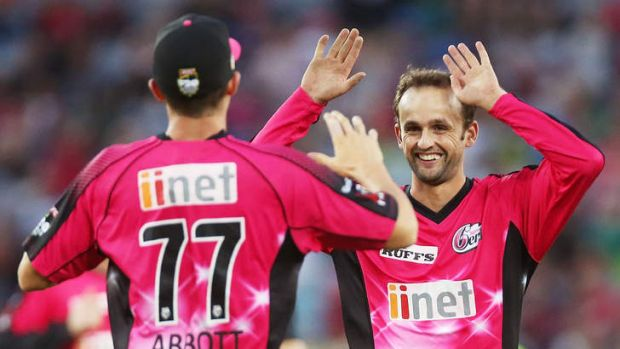No hard feelings: Sixers players Sean Abbott (left) and Nathan Lyon celebrate dismissing Mike Hussey of the Thunder on ...