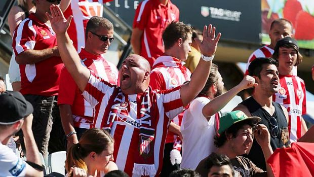 Melbourne Heart fans cheer their team during the round 16 match against Adelaide United.