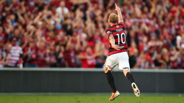 Time to celebrate: Aaron Mooy of the Wanderers.