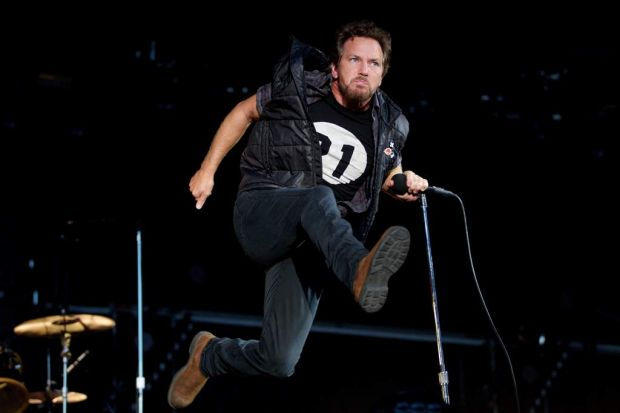 Eddie Vedder from Pearl Jam performing on stage.