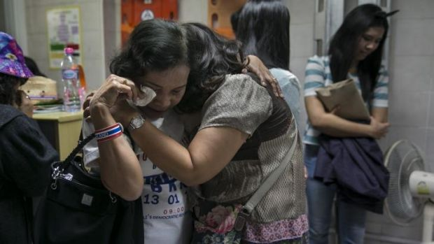 Family and friends of a Thai anti-government protest leader, who was shot dead, grieve at a hospital.