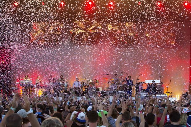 Confetti covers the crowd as Arcade Fire play the final set on the Orange stage.