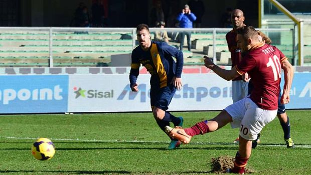 AS Roma's forward Francesco Totti scores from the penalty spot against Hellas Verona.
