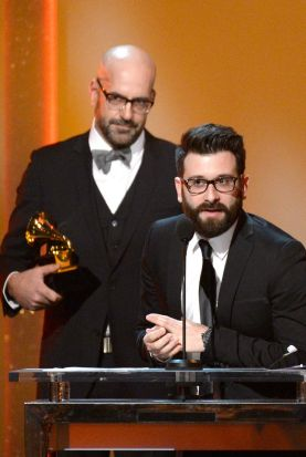 Producers Chris Stevens (L) and David Garcia accept the Best Contemporary Christian Music Album award for 'Overcomer'.