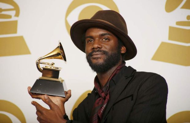 "Gary Clark Jr. poses backstage with the award for best tradional R&B performance for ""Please Come Home""."