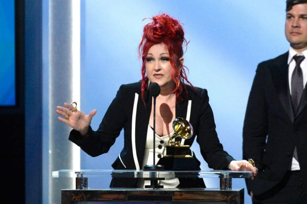 Singer/songwriter Cyndi Lauper accepts the Best Musical Theater Album award for 'Kinky Boots'.