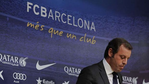 Barcelona's football club president Sandro Rosell announces his resignation on January 23, 2014.