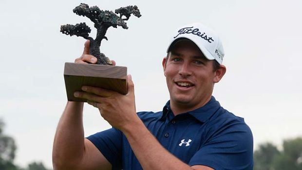 Scott Stallings stands with his trophy after winning the Farmers Insurance Open on Torrey Pines South.