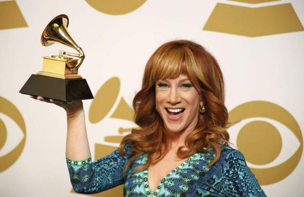 "Kathy Griffin poses backstage with the award for best comedy album for ""Calm Down Girl""."