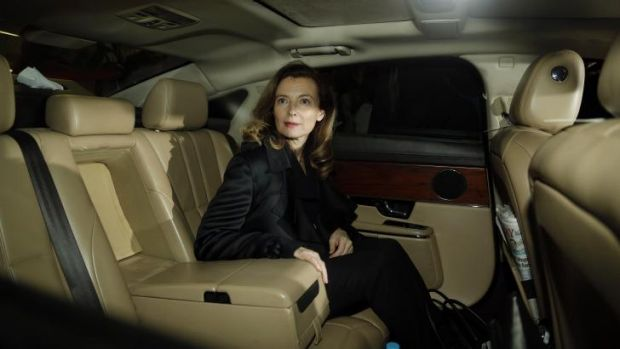 Valerie Trierweiler, former partner of French President Francois Hollande, looks on from a limousine after her arrival ...