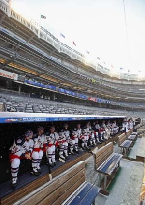 The New York Rangers wait in the dugout.