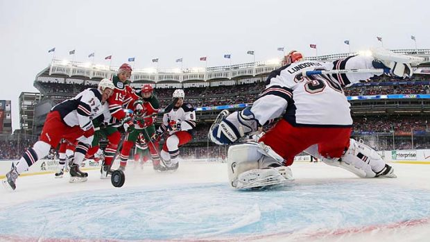 Travis Zajac New Jersey Devils scores a first period goal against the New York Rangers at Yankee Stadium.