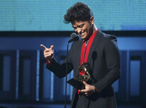"Bruno Mars accepts the award for Best Pop Vocal Album for ""Unorthodox Jukebox""."