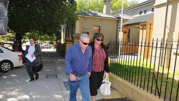 Alleged one-punch attacker Karl Sibley's mother and step-father leave Orange Local Court after the accused's hearing on ...