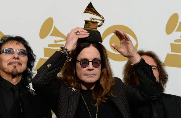 Tony Iommi (L), Ozzy Osbourne (C) and Geezer Butler (R) of Black Sabbath pose in the press room after winning Best Metal ...