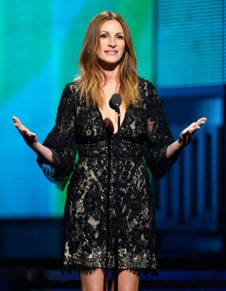 Actress Julia Roberts presents at the 56th Grammy Awards.