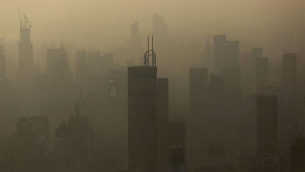 Smog hangs in the air around buildings in the Luohu district of Shenzhen.