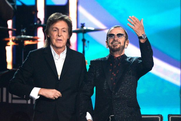 Musicians Paul McCartney (L) and Ringo Starr of The Beatles perform at the 56th Grammy Awards.