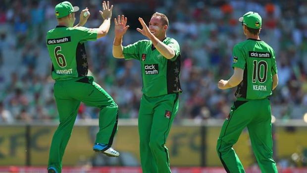John Hastings of the Stars (centre) congratulates Luke Wright after he took a catch to dismiss Mitchell Marsh of the ...