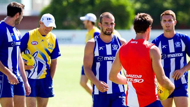 Stepping up: Ben Cunnington (centre) at training.