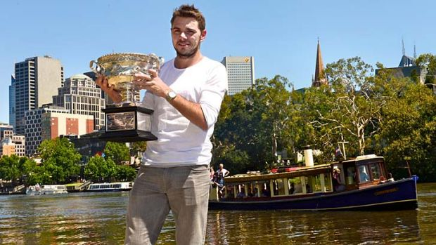 The man: Stan Wawrinka holds the trophy on Monday after his victory in the Australian Open men's final the previous night.