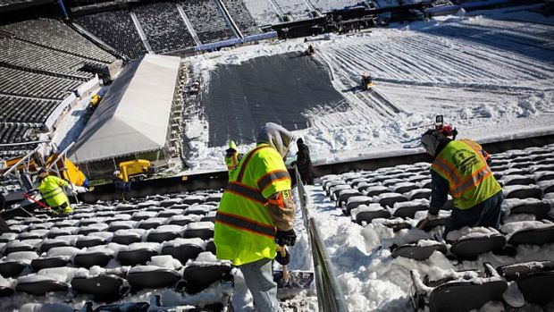 Crews work to remove snow from MetLife Stadium, which will host Superbowl XLVIII.