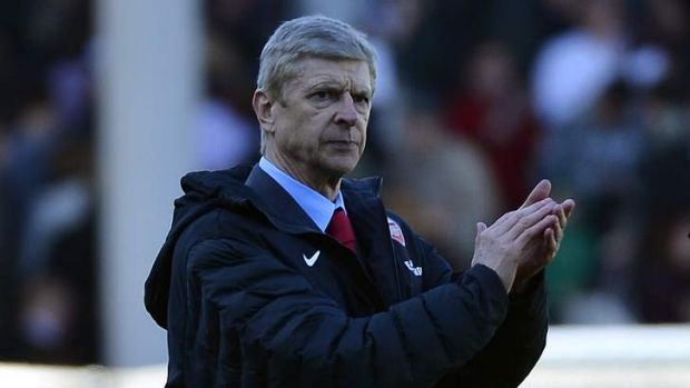 Plenty to cheer: Arsene Wenger's new three-year deal at Arsenal is understood to be worth more than $45 million.