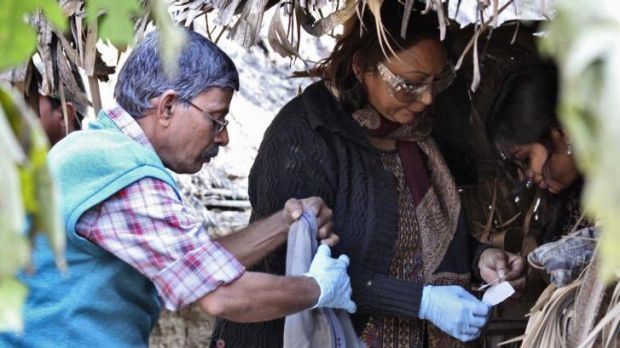 Forensic experts collect samples from an area where a woman was gang-raped at Birbhum district in the eastern Indian ...