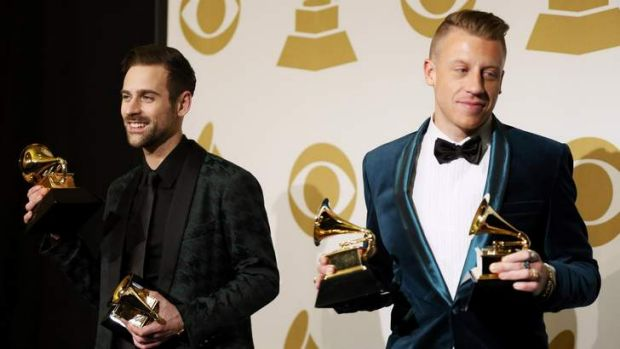 Macklemore (right) and Ryan Lewis pose backstage with their awards.