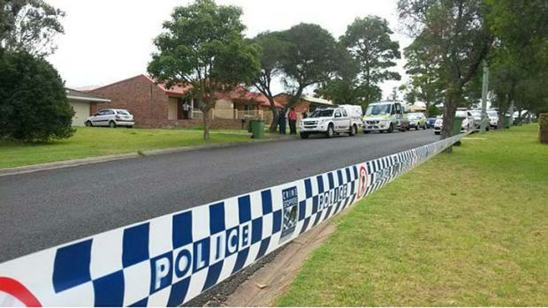 Police have established a crime scene in Redwood St where it is reported two people have been stabbed to death.