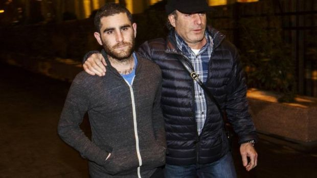 Arrested: Charlie Shrem (left) leaves court in New York after being charged with money laundering.