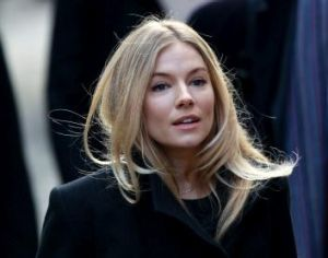 <i>News of the World</i> editor Andy Coulson listened to Sienna Miller's voice message for Daniel Craig before scheming ...