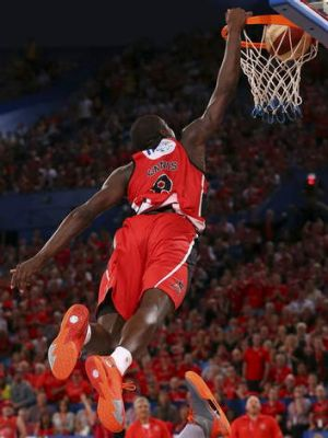 James Ennis of the Wildcats dunks the ball.