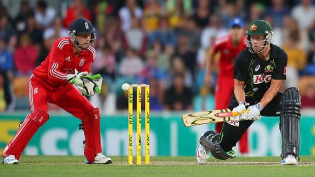 Cameron White reverse sweeps during his knock of 75 in the first T20 game against England in Hobart on Wednesday.