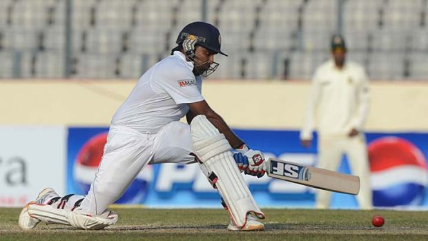 Sri Lanka's Mahela Jayawardene attempts a reverse sweep during his innings of 203 not out.