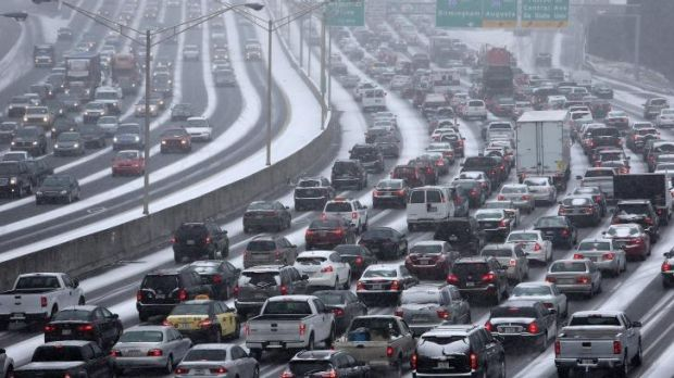 Gridlock ... Traffic crawls along a highway as snow blankets the Atlanta on Tuesday afternoon.