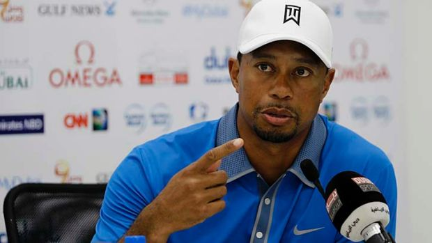 Tiger Woods speaks to the media at the Emirates Golf Club in Dubai on Wednesday.