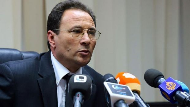Survived: Libyan Deputy Prime Minister Al-Siddiq Karim speaks to the media after an attempt on his life in Tripoli.