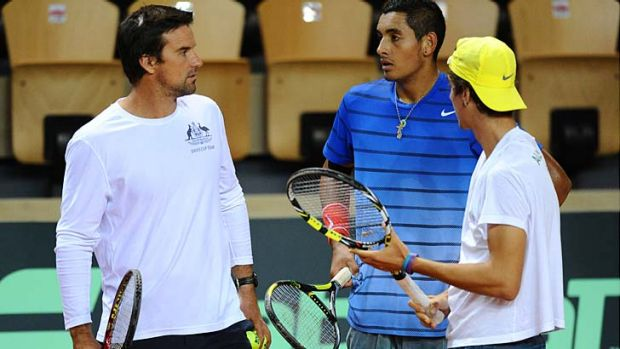 Australia's Thanasi Kokkinakis (right) and Nick Kyrgios (center) talk with their captain Patrick Rafter during in a ...