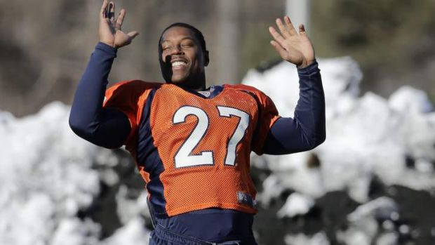 Cold stretch: Bronco Knowshon Moreno limbers up during a snowy training session this week.