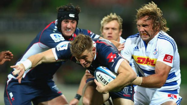 On the run: Jason Woodward shows his style for the Rebels. He says the club is fired up for 2014.