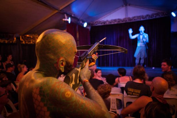 Shoot to thrill ... Lizardman shoots a crossbow at Space Cowboy, who catches the arrow at the end of the show.